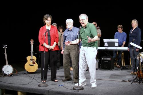 Ester Lieber watches, Steve Bishop waits and Ken Roush sings. At the right are Mike Evans, Musical Director, and Nancy Pranckus.